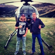 Mike in New Zealand flying in the red bull helicopter!
