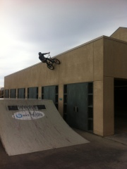 Going huge and keeping it fresh Team Soil rider Chris Hughes rides a vertical wall.